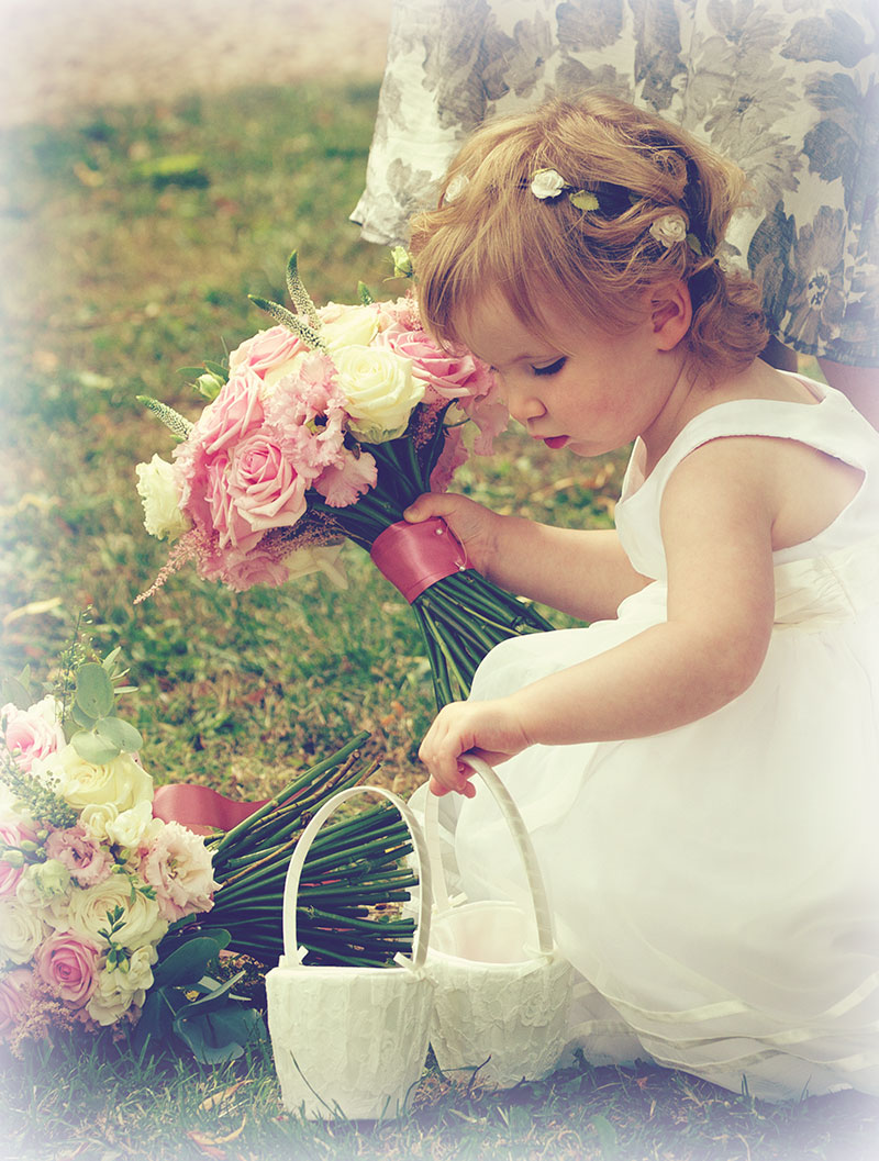 Cute flower girl captured at an Oundle wedding