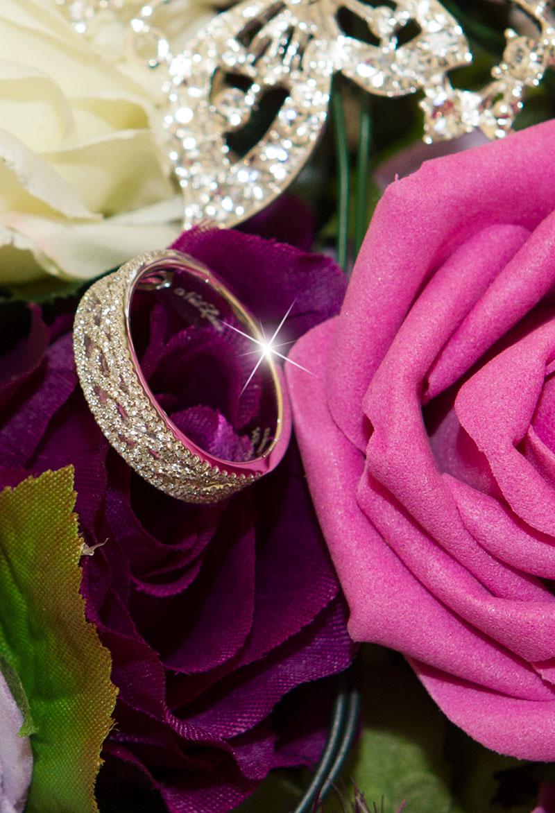 Wedding ring on rose - St Neots wedding photographer
