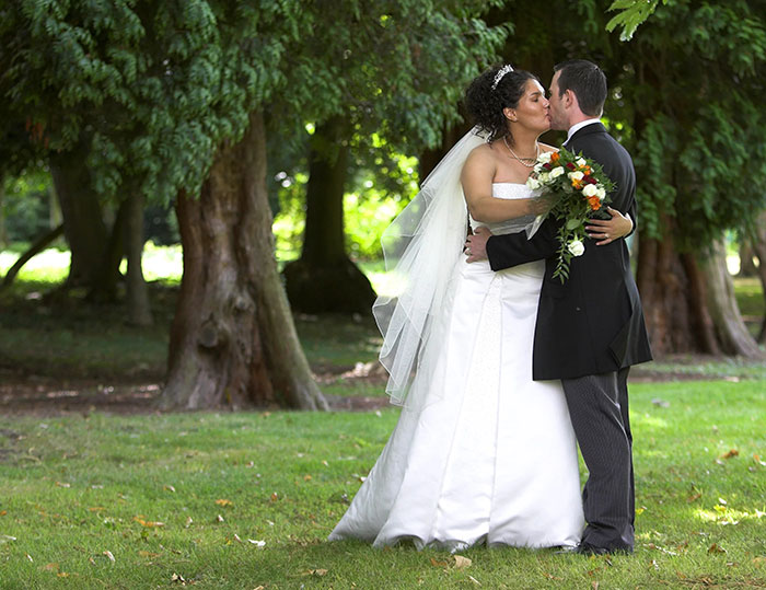 Orton Hall wedding photographer - kissing couple